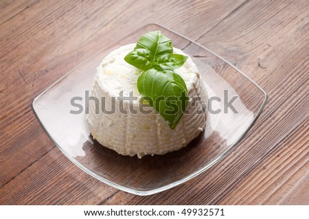 dish with ricotta and basil - stock photo