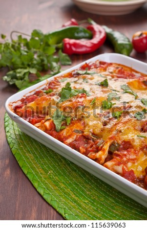 dish with traditional mexican food enchiladas - stock photo