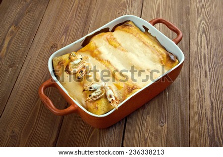dish with traditional mexican food enchiladas with seafood - stock photo