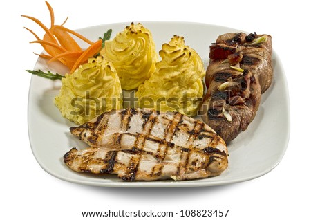 Dish with various meats and mashed potatoes with cheese cream- isolated - stock photo
