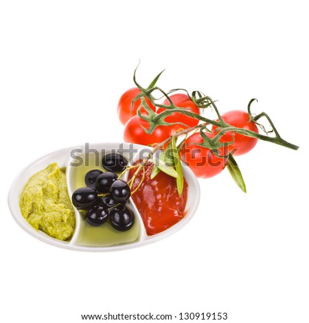 dishes for sauces with three different kinds of sauces, and a sprig of cherry tomatoes isolated on white background - stock photo