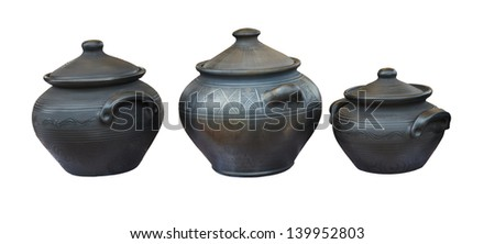 Dishes made �¢??�¢??of baked clay isolated on white background. - stock photo