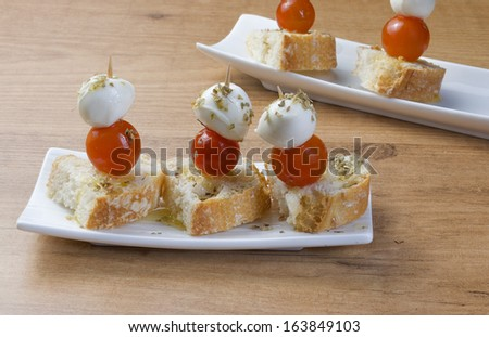 dishes of cheese with tomato morsel - stock photo
