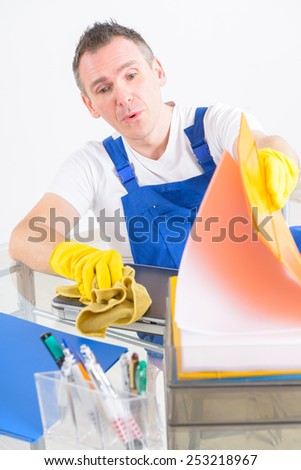 Dishonest or curious man cleaner looking at the papers - stock photo