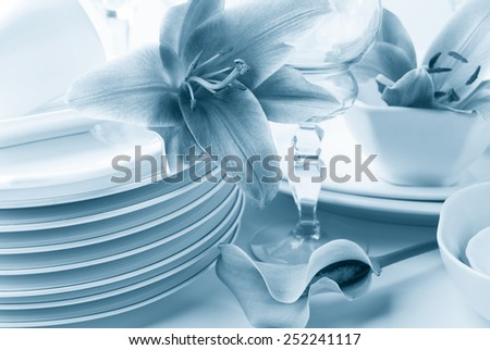 Dishware and lilies - stock photo