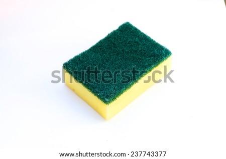 Dishwashing sponge on white background - stock photo