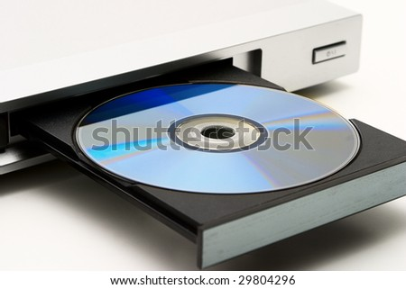 Disk drive in DVD player on a white background. Light shade. - stock photo