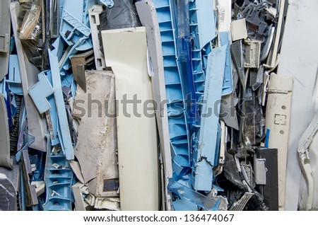 dismantled pastic computer parts for electronic recycling - stock photo