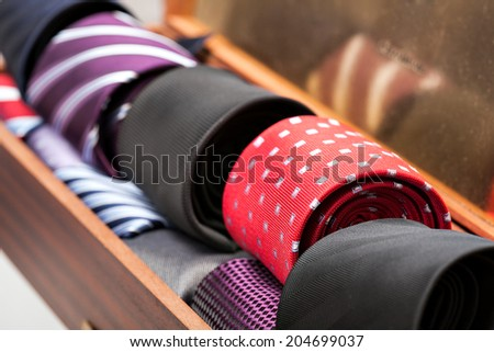 Display of different patterns and colours of man ties in a shop or showroom - stock photo