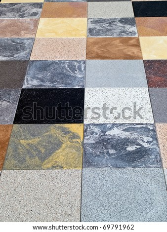 Display of different stone granite floor tiles for outdoors garden and indoors - stock photo