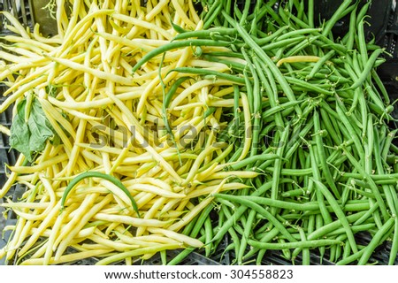 Display of green and yellow snapo beans at the market - stock photo