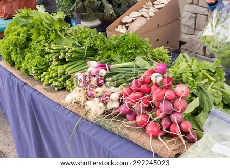 Display of local organic produce at outdoor farmers' market - stock photo