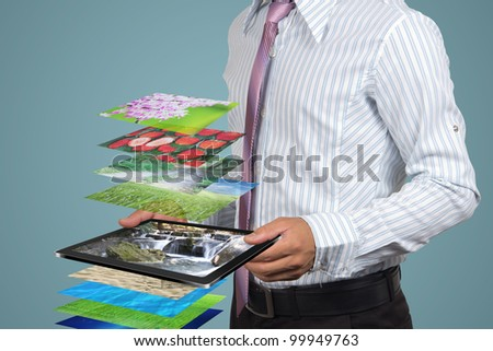 Display on tablet in the hands businessman. - stock photo