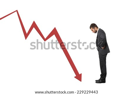 displeased businessman looking at red downturn graph. isolated on white background - stock photo