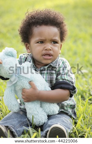 Displeased young toddler - stock photo