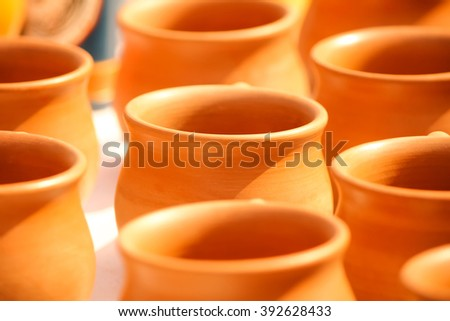 Disposable clay cups in a row - stock photo