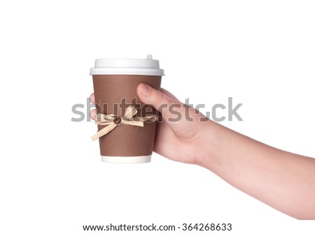disposable cup of coffee in hand isolated on white background - stock photo