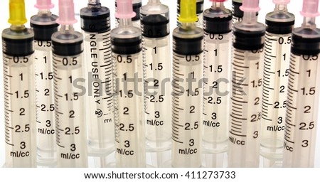 Disposable plastic transparent syringes and needles  - stock photo