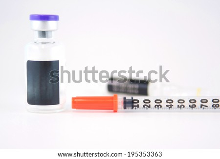 Disposable syringe and injection vials - stock photo