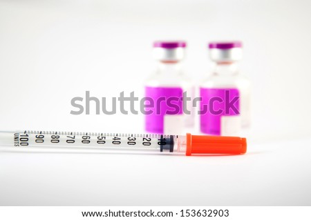 Disposable syringe and purple label injection vial show medicine background - stock photo