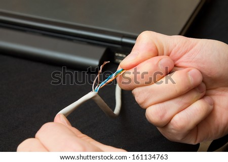 disrupt the network cable with power - stock photo