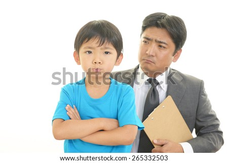 Dissatisfied Asian boy - stock photo