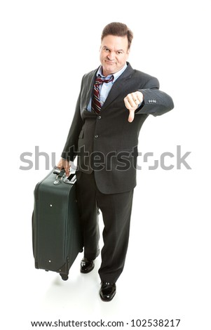 Dissatisfied business traveler giving thumbs down on his travel experience. - stock photo