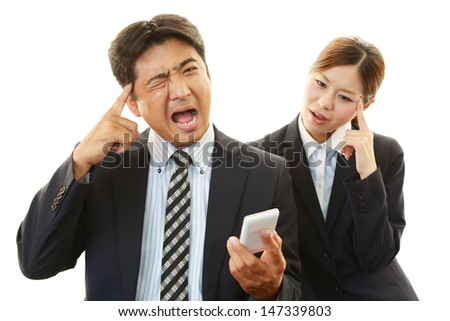 Dissatisfied businessman and businesswoman - stock photo
