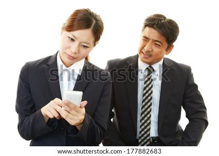 Dissatisfied businessman and businesswomen  - stock photo