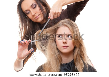dissatisfied model in hairdressing salon. isolated on white background - stock photo