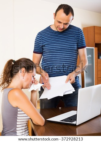 Dissatisfied woman customer complains to angry agent of insurance - stock photo