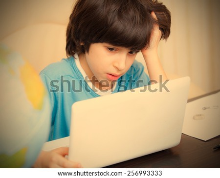 distance learning, a boy with computer. instagram image retro style - stock photo