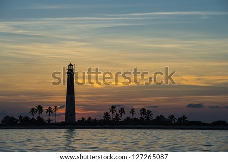 Distance view of a Dry Tortugas lighthouse at scenic sunset - stock photo