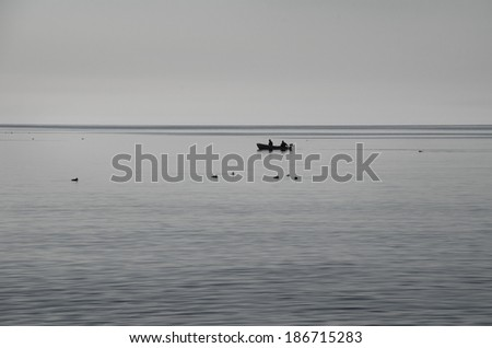 Distant boat in the horizon - stock photo