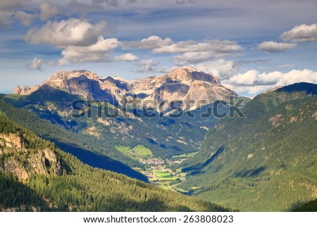 Distant clouds above summits and valleys of the Dolomite Alps, Italy - stock photo
