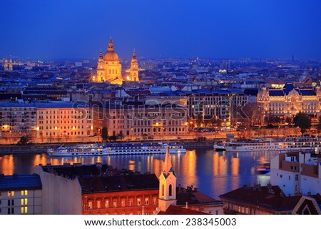 Distant dome of St Stephen church and Danube river banks at evening in Budapest, Hungary - stock photo