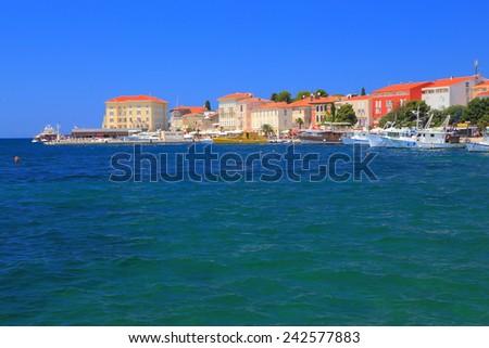 Distant harbor of an old town near the Adriatic sea, Porec, Croatia - stock photo