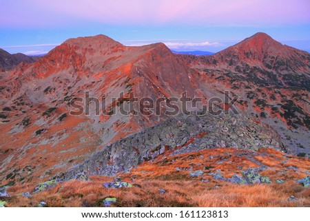 Distant mountain peaks before dawn - stock photo