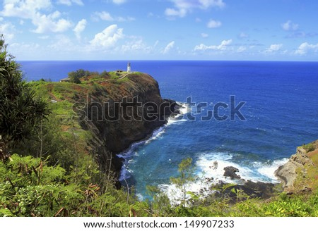 Distant view of Kilauea Point Lighthouse, perched at the end of a peninsula in the Kilauea Point National Wildlife Refuge. - stock photo