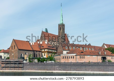 Distant view on The Church of the Holy Cross in Wroclaw, Poland. The Gothic church is located in the Ostrow Tumski the oldest part of the city. - stock photo