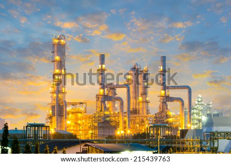 Distillation tank of oil refinery plant, twilight time. - stock photo