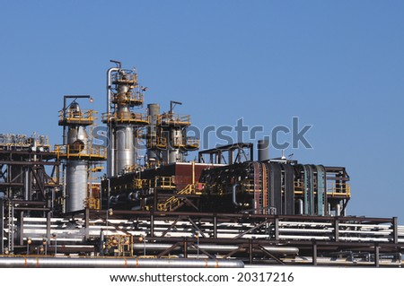 Distillation towers and oil and gas pipelines at a petrochemical plant - stock photo