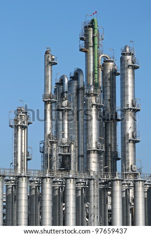 Distillation towers at a chemical plant - stock photo