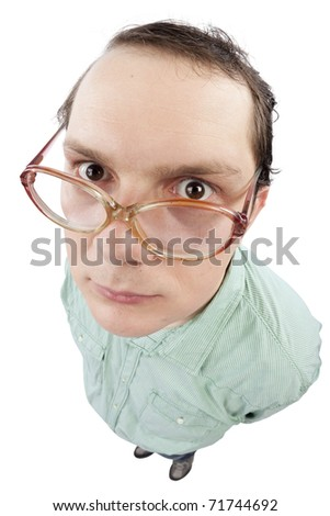 Distorted image of a nerd staring at the camera. Fish-eye lens used. Studio shot. Isolated on pure white background. - stock photo