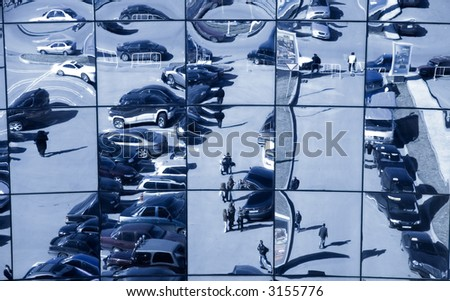 Distorting reflection. Windows of the big modern exhibition center. - stock photo