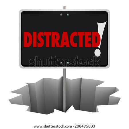 Distracted word on warning sign in a deep hole to illustrate danger, hazard or risk and the need to pay attention - stock photo