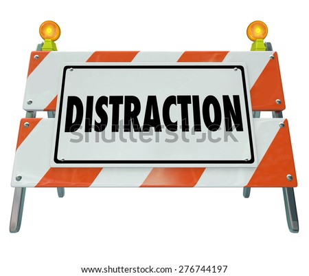 Distraction word on a road construction barrier or sign to illustrate dangerous inattentive driving or hazardous situation - stock photo