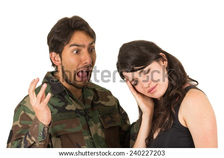 distraught military soldier veteran ptsd fighting with wife isolated on white - stock photo
