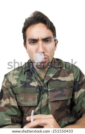 distraught military soldier veteran ptsd smoking a cigarette isolated on white - stock photo