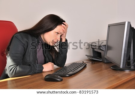 distraught woman in the workplace - stock photo